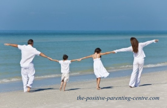 the positive parenting centres Happy family walking on beach
